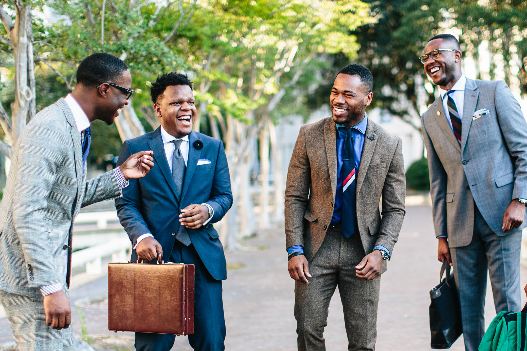 Group of businessmen talking and laughing.